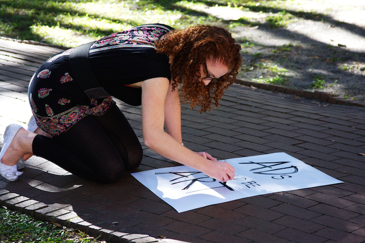 Lauren Lenart, fourth-year Advertsing student, made a sign before the protest began.